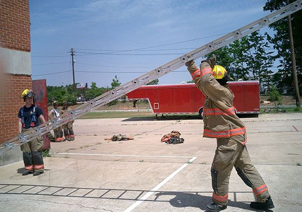 Firefighter using proper technique to set up a ladder