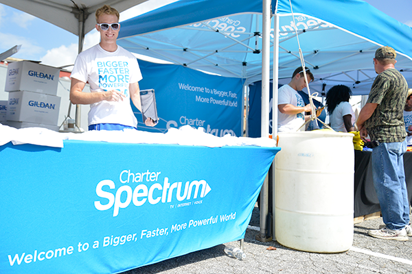Photo of Charter employee in a booth at an event