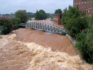 Floodwaters overflowing the low-head dam located just upstream of Main Street in downtown Greenville